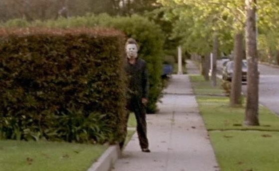 Michael Myers behind a hedge in Halloween